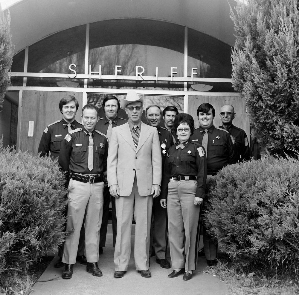About 1976-The sheriff's office staff included, front-left to right, Charlie Davis, Sheriff Pete Weaver, Maxine Randolph. Back-left to right, Roy LeForce, Junior Pair, Bucky Dunn, Bob Tafoya, Rick Stephens, Al Boyer. Weaver was sheriff from 1969-1971 and 1973-1981.